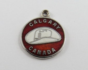 Enameled Calgary Alberta Canada with Picture of Cowboy Hat Sterling Silver Charm or Pendant.