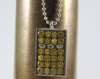"""Bullet Primer Necklace: Spent Brass and Nickel Bullet Primers Set in a Nickel Pendant on a 30"""" Nickel Plated Ball Chain."""