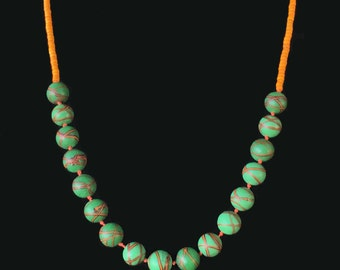 Vibrant necklace of vintage Venetian, Ercole Moretti, Murano beads with antique trade beads in orange and green