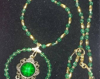 Green and gold tone beaded necklace.