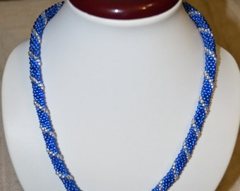 Crocheted bead necklace in blue with silver Spiral