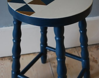 SOLD * Painted blue vintage stool with unique geometric patterned seat, carved legs