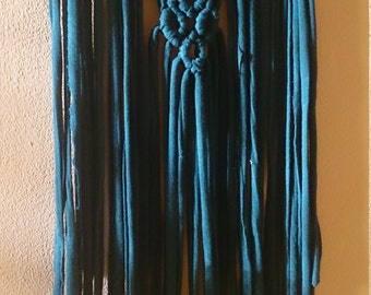 Macrame wall hanging . Macrame tapestry woven in Dark green agate. a rug with green agate