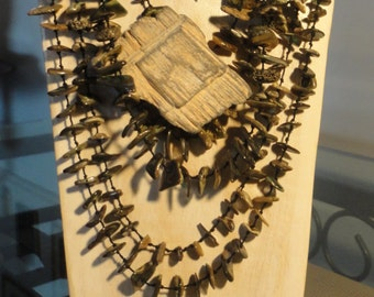 Pearl necklace and driftwood