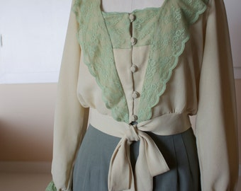 oatmeal colored chiffon and mint green lace blouse gathered lace cuffs 5 covered buttons loop closure self tie belt