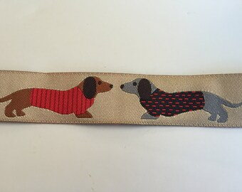 Dachshund Ribbon yardage. New on roll. Jennifer Jones for Renaissance ribbons. Doxie dogs on tan with sweaters. Wiener dog
