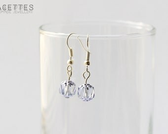 Earrings with silver ear wires and a light blue glass bead