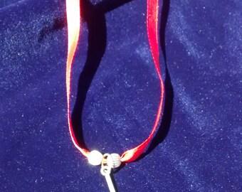 Ribbon axe necklace