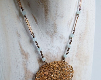 Print oval brass and aquamarine necklace