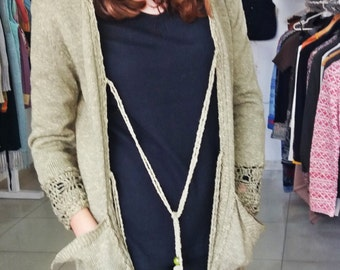 Olive green machine-knitted topcoat with hand-knitted details