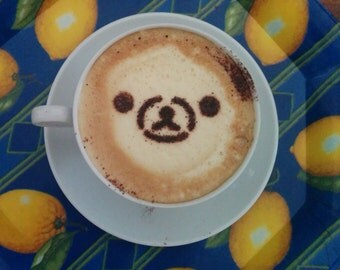 Cappuccino stencils in the shape of a teddy bear for cocoa powder printed in 3D