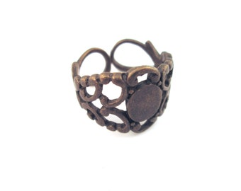 5 brass filigree rings, with a 6x8mm glue on pad