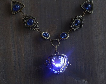 Neo Victorian Jewelry - Necklace - Blue Heart locket with glowing orb Antique Bronze