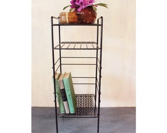 vintage side table - black wire bookshelf - plant stand