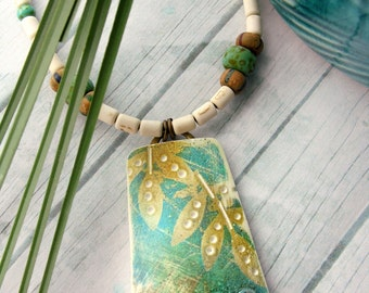 Polymer Clay Necklace Jewelry featuring a Textured Boho Design in Teal, Gold and White