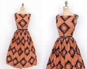 Vintage 1950s Dress / 50s Batik Print Cotton Dress / Orange and Black (M L)