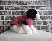 Dog sweater in pink with fur trim, size med., large.