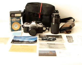 vintage CANON AE-1 camera with TELEPHOTO lens, original manuals and carrying case Single Lens Reflex manual optimal camera