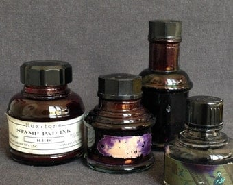 Instant collection of four antique ink bottles. Retro office supply home decor.