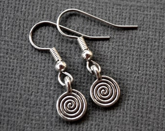Small Silver Spirals . Earrings