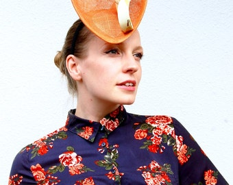 Orange modern high fashion percher cocktail fascinator hat