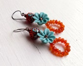 Handmade stacked orange and aqua-blue turquoise earrings, featuring handwoven glass, carnelian and artisan polymer - Songbead UK, narrative