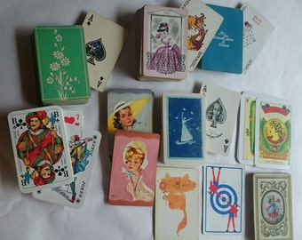 Graphics to behold. Vintage card decks. Colorful playing cards