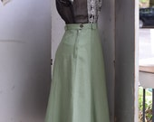 RESERVED... 1930s - 1940s Moss green skirt with bakelite button