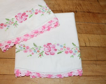 Vintage set of embroidered pillowcases with pink flowers