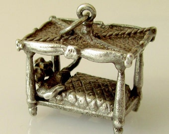 Silver Couple in Four Poster Bed Moving Charm