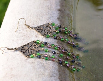 Playful long earrings, with a combination of beautiful bronze, sassy green and peaceful purple