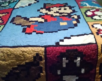 Custom for Winnie - Throw Size Goomba / Mario Quilts (two)