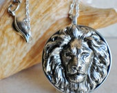 Lion music box locket,  round locket with music box inside, in silver with silver lion.