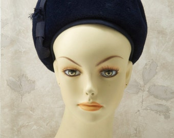 Chevalier womens navy blue wool hat. Sold by Gimbles. 1960s