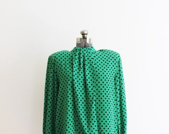 Emerald green and black polka dot silk secretary shirt. 1980s. Size L or XL.