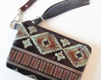 Brown leather wristlet in embossed Southwestern style leather.