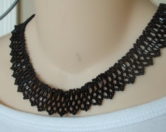All black bib necklace, lacy look.