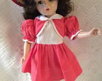 """Vintage hard plastic 1950's doll/14"""" tall"""