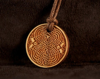 Celtic Art Pendant Etched in Cherry Wood from The Book of Kells, made in Scotland.
