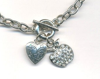 Girls bracelet with heart locket and apple with diamentes charm