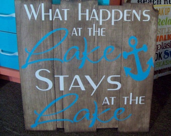 Wooden sign: what happens at the Lake stays at the Lake
