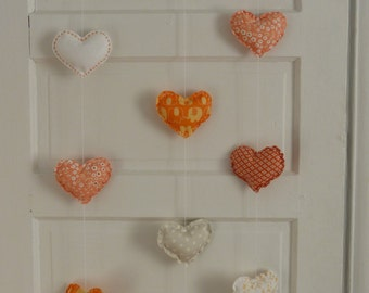 Mobile orange hearts
