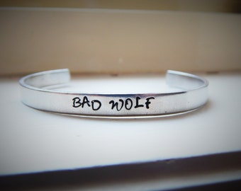 Bad Wolf, Hand Stamped Aluminium Cuff Bracelet