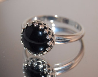Black onyx ring set in sterling silver bezel