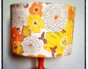 Handmade lampshade with repeated vintage inspired floral pattern in yellow, orange, beige, brown and mustard