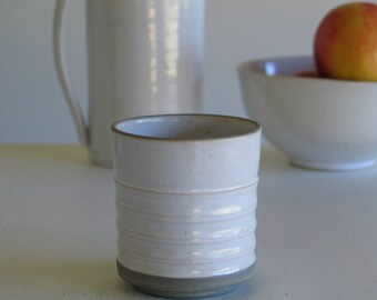 Ceramic Cup. Fluted straight Cup. Goblet, mug pottery. Cup white enamel and grey engobe. White enamel. Turned stoneware by hand.