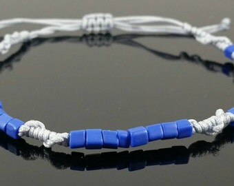 Grey macreme twist bracelet with royal blue beads.