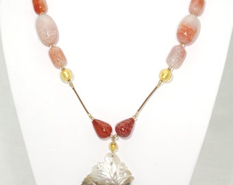 BN080- Intricate carved Mother Of Pearl and colorful Fire Agate necklace
