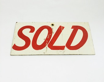 Vintage sold sign, from the 1950s