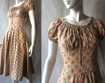 1950's cotton leaf print dress, coral, chartreuse, gray, and cream, with full skirt, fitted bodice, gathered neckline, & puff sleeves, small